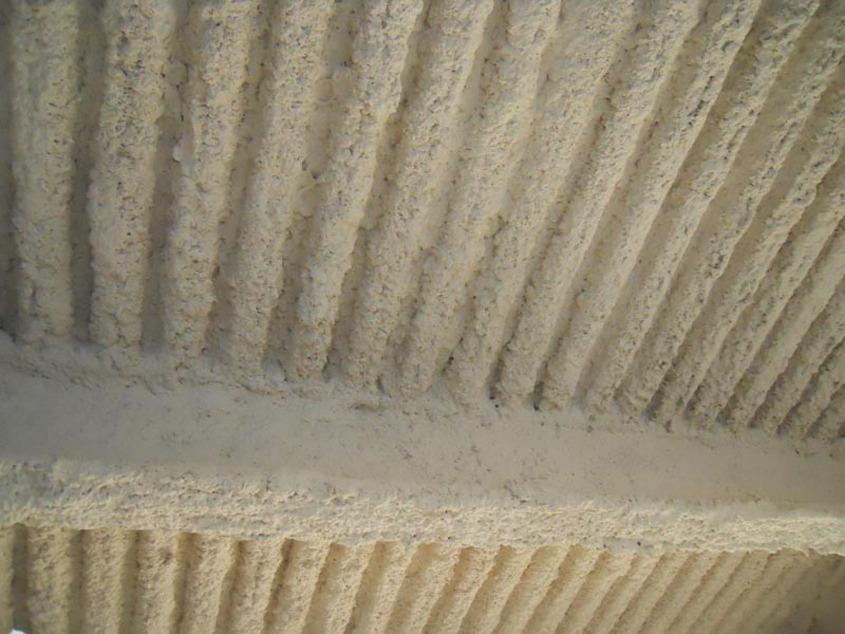 igniver-intonaco-antincendio-spruzzato-su-lamiera-gragata-e-travi-in-ferro - Stevanato | Soluzioni per umidità e infiltrazioni